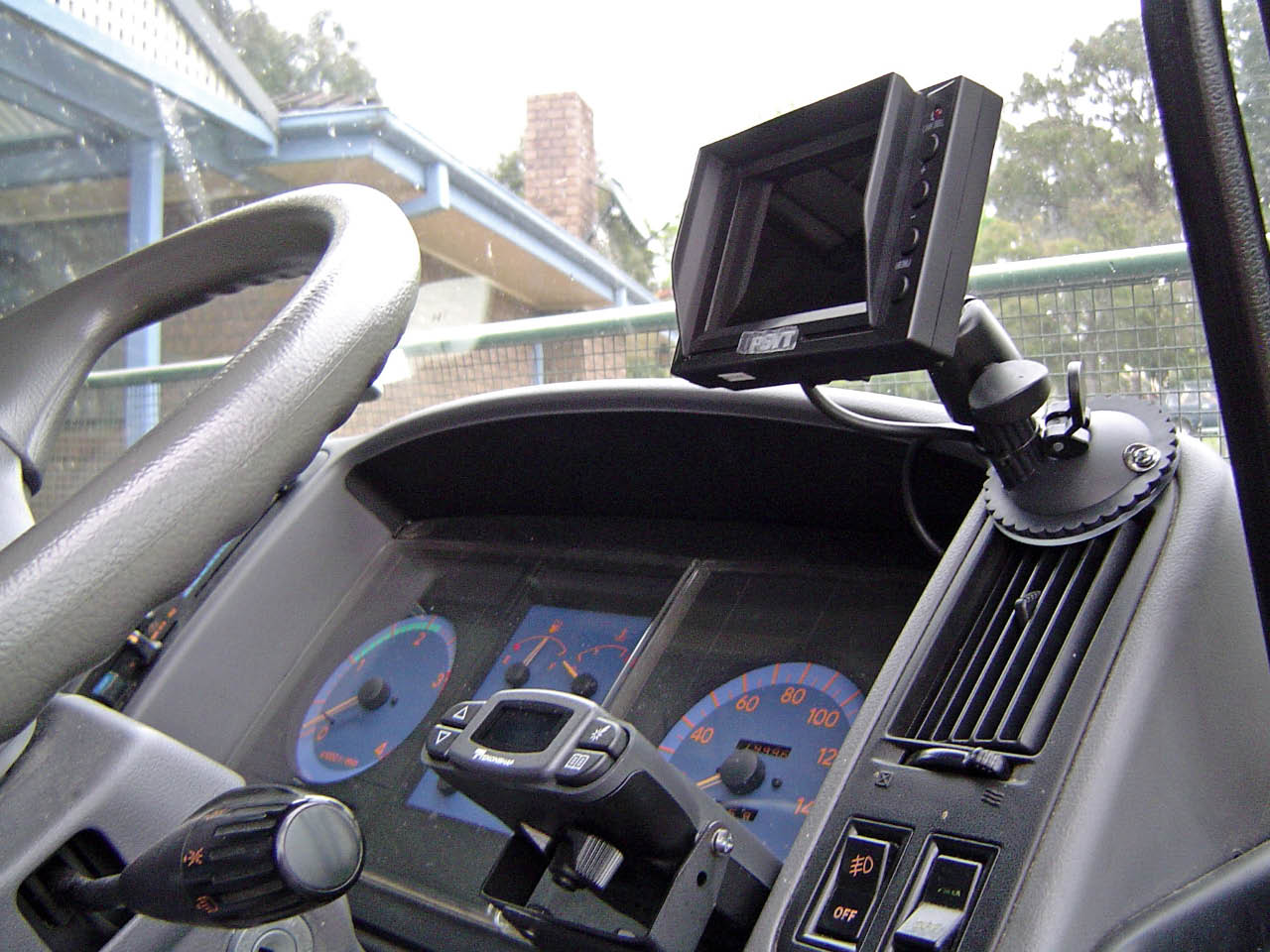 Top is camera monitor, lower is Brake Controller.