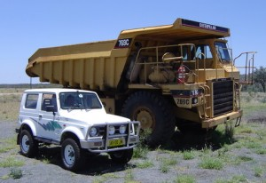 The Suzi driver has set a goal to drive a bigger version of this type of dump truck - somewhere, sometime