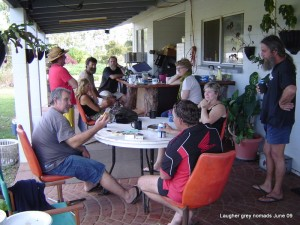 Marc's mate Grizz (far right), on his veranda - warming up for a jam session. Fellow riders Mike, Terry & Karen round the table.
